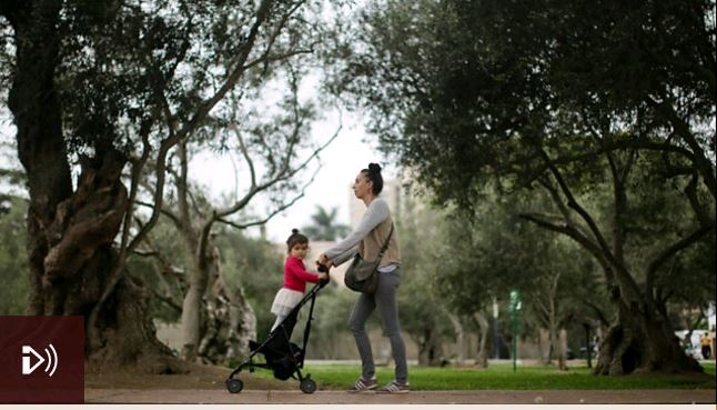 Image: A woman pushes a child in a pram, Credit: Getty Images